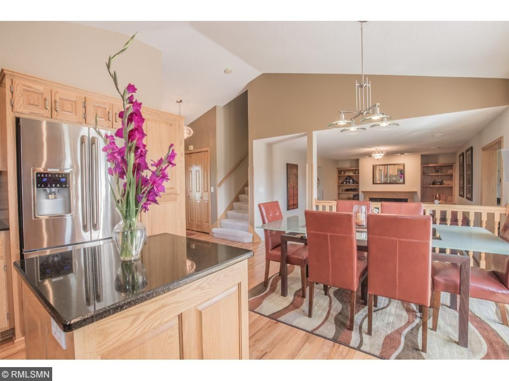 Vaulted ceiling and abundant cabinetry.