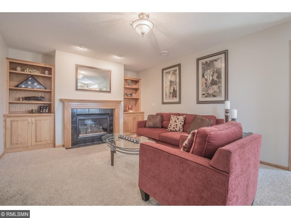 Living room features gas fireplace flanked with built-ins.