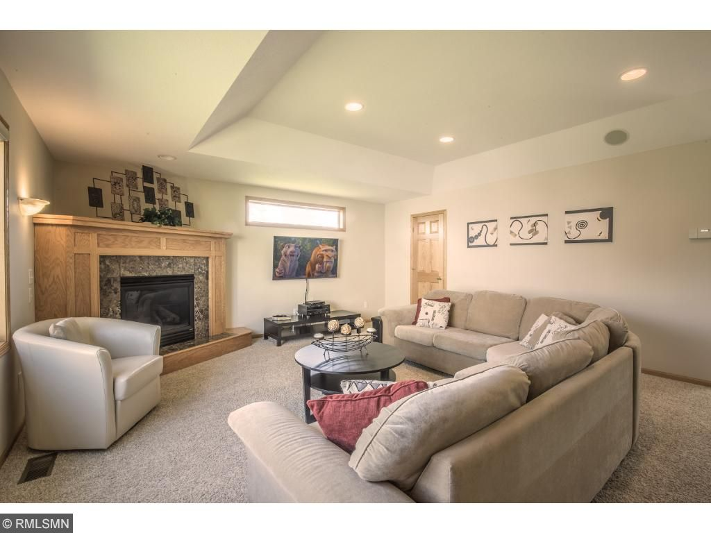 Great room offers corner fireplace and  game/storage closet.