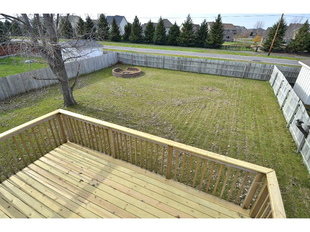 Enjoy looking over the spacious back yard from the rebuilt deck.