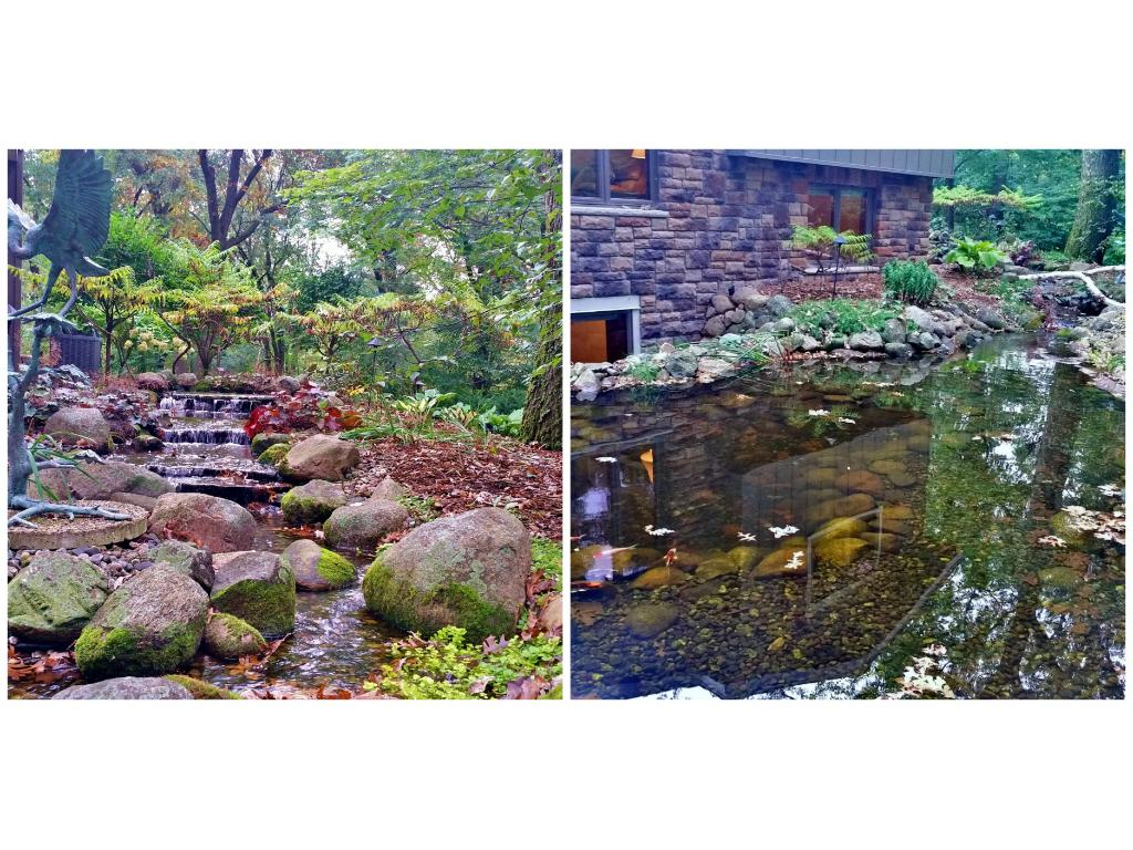 Elegant Koi Pond fed by a multi tiered waterfall and small stream!