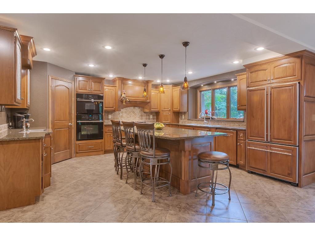 Stunning chefs kitchen! This kitchen features built in Jenn Air appliances, gas cooktop with hood, and wall oven and microwave. Huge French door bottom mount refrigerator!