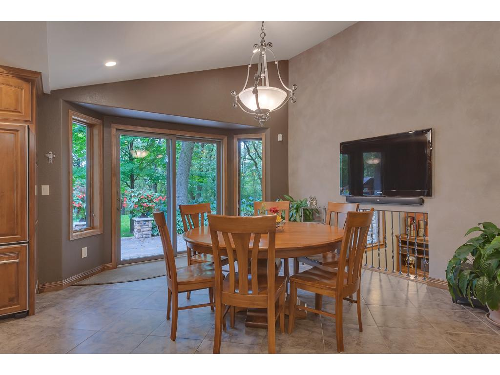 Large open dining area that walks out to the amazing patio and overlooks the gorgeous landscape!