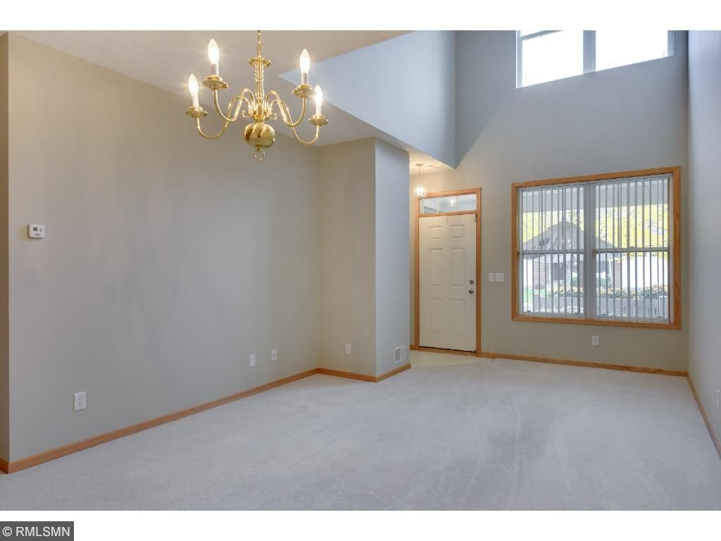 Entry way opens to spacious living room.