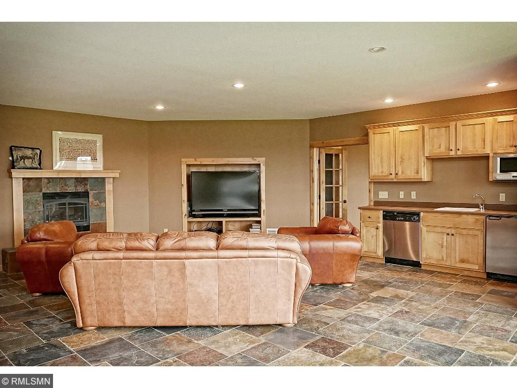 Lower level amusement room with slate surround gas fireplace; wet bar; adjacent to large exercise or craft room