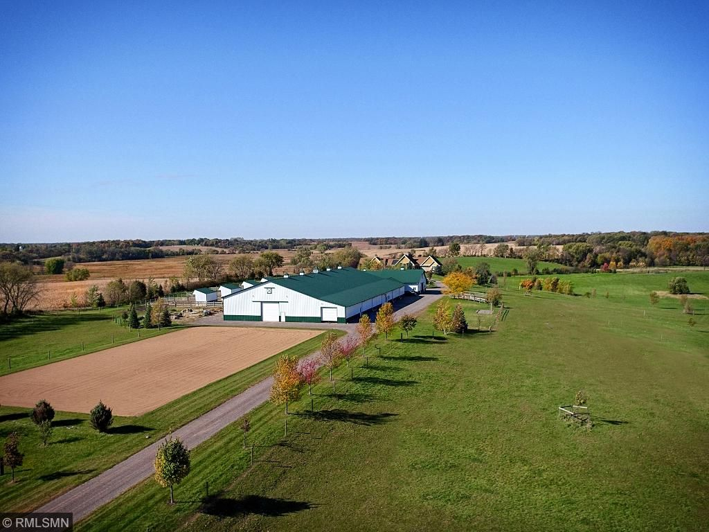 Barn complex with indoor arena and 100' x 200' outdoor ring. 5 pastures with Nelson waterers; 4 paddocks - 50' x 100' each with 12' x 24' run in shed; 4 board fenced mare/foal pasture