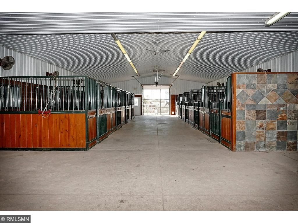 Heated Barn with 9-12'x12' box stalls by Classic Equine; tongue/groove Georgia Pine; Comfort stall mat system; Nelson waterers; adjustable fans for each stall; windows in each stall; 14' aisle; central vac; 12' ceiling height; in floor heat