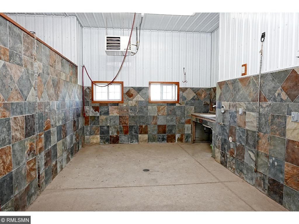 Wash stall 11'x15'; slate walls; sink and counter; cold and hot on demand water, central vac. Additional Barn features: automatic sensor lighting in key areas; Screens for each 10'x10' overhead doors; built in sound system speakers. Feed Room: 07'x12