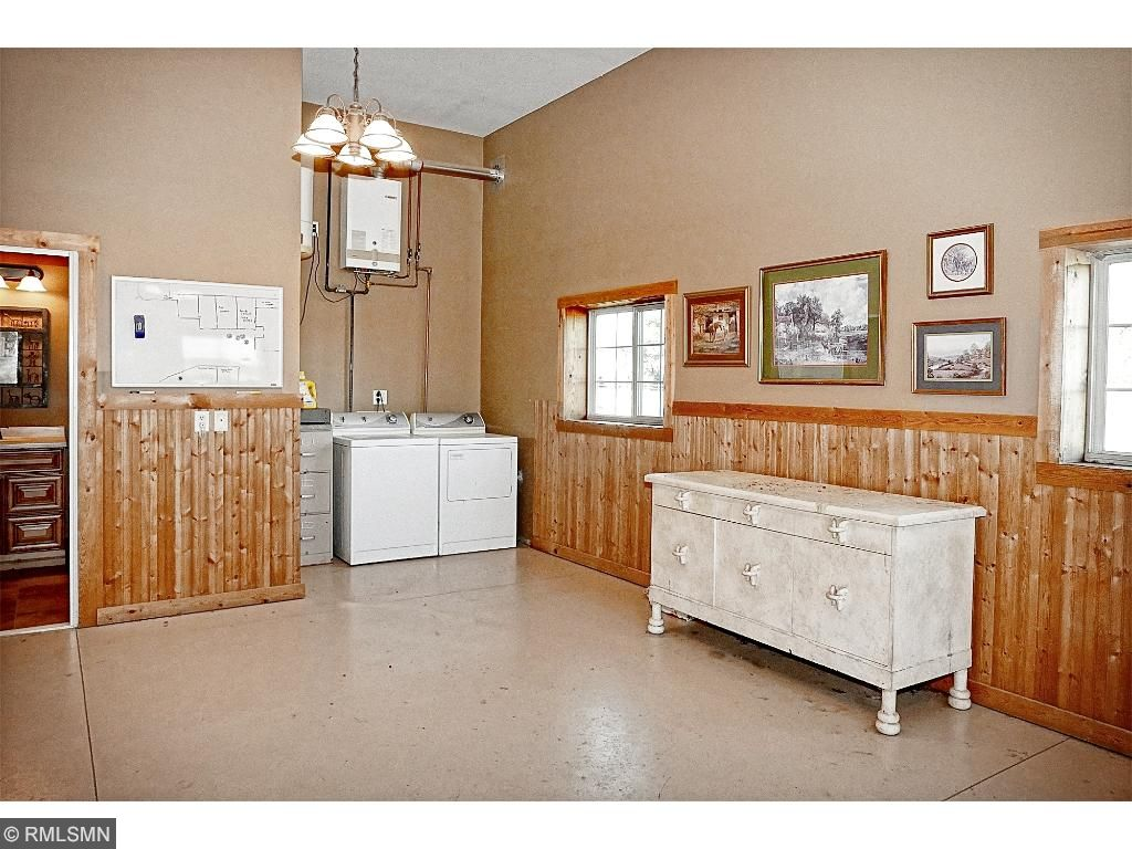 Lounge: 12'x24'; 1/2 bath; bead board walls; washer/dryer; in floor heat; access to barn and outside. Additional Barn Amenities: 2-8'x15' Tack Rooms ; Storage Room: 10'x10'