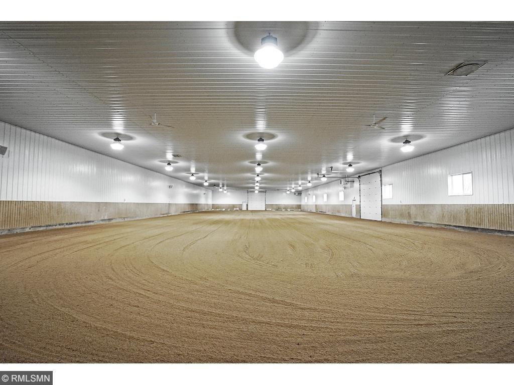 "Heated indoor arena: 74'x198'; ventilated; 16' ceiling height; 24-400 watt metal Halide lights; 2-14'x14' exterior, overhead doors; 6"" ag lime footing with 2"" sand base. Cold storage 20'x96'; Shavings storage 12'x14'; Hay storage 20'x66'-1400 bales."