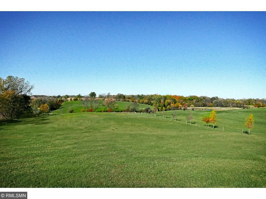 Rolling pastures; 3 outdoor water hydrants; outdoor wash area;  creek running through the property; 3 ponds