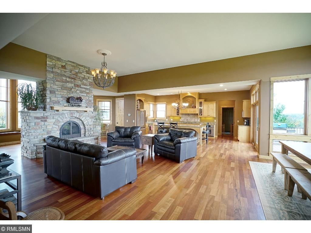 Large open spaces perfect for everyday living and entertaining; Brazilian cherry floors, Alder millwork; full stand alone Chilton rustic stone see thru fireplace; 13' ceilings