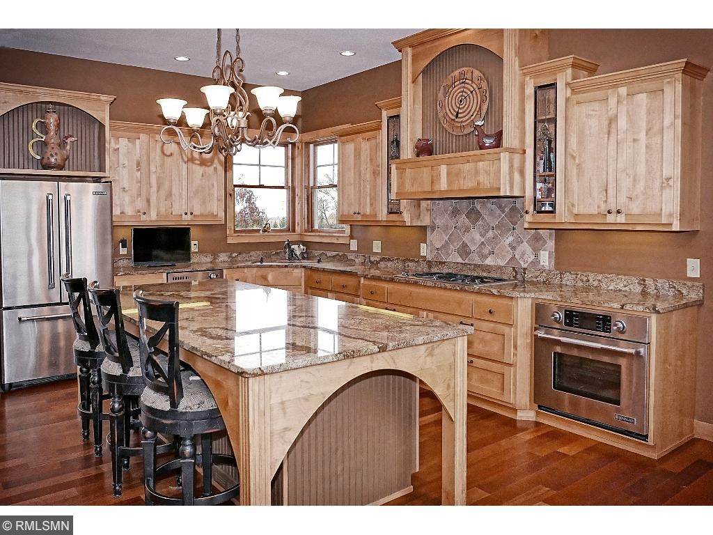 Chef's kitchen with stainless appliances; 4'x9' center island with sandwich bar; adjacent to mud/laundry room and 3 car heated garage; walkout to deck for grilling...