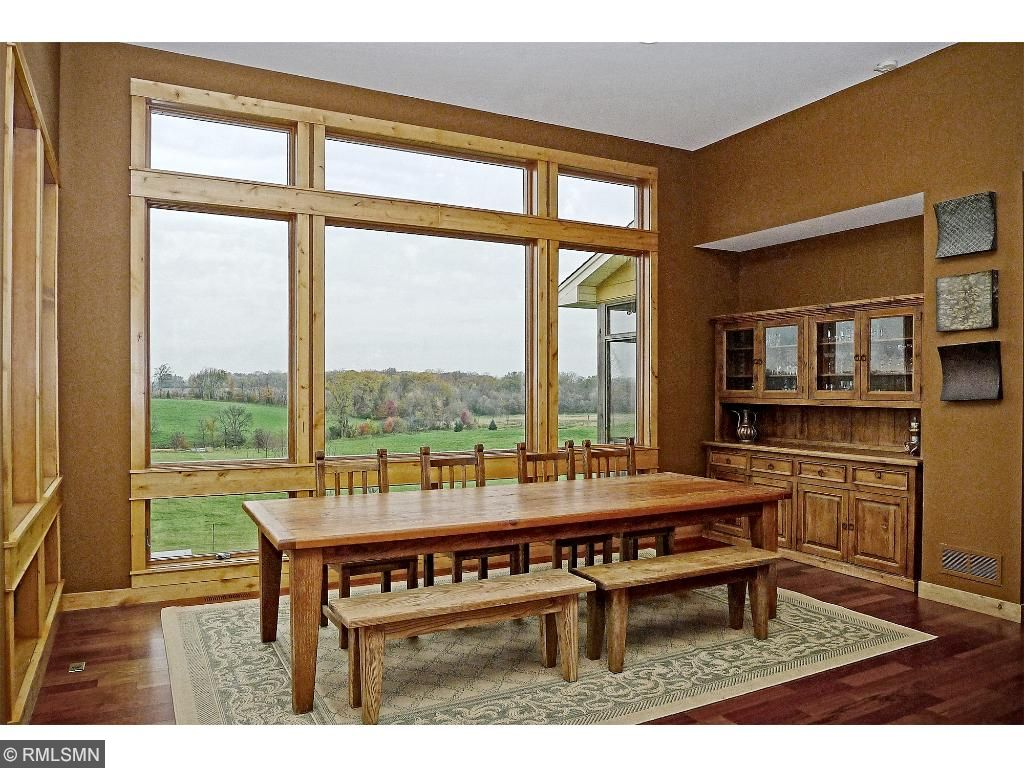 Dining area with built in hutch. Full wall of windows.
