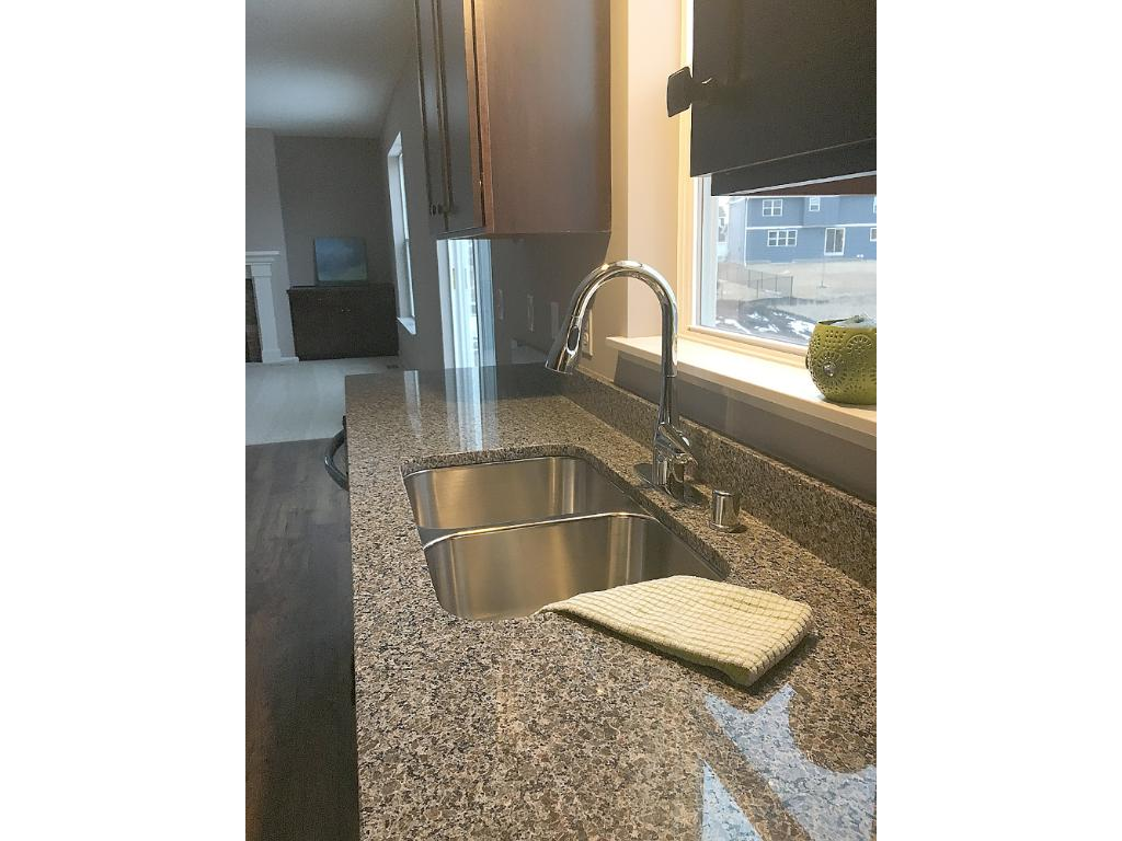 Double sinks in owners bath with plenty of space for two.  Photos are of similar home.