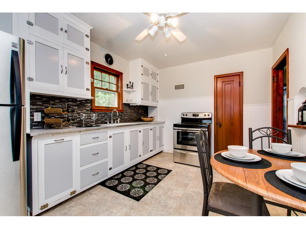 Kitchen Overlooks Large Backyard and Has Original Cabinets & Pantry