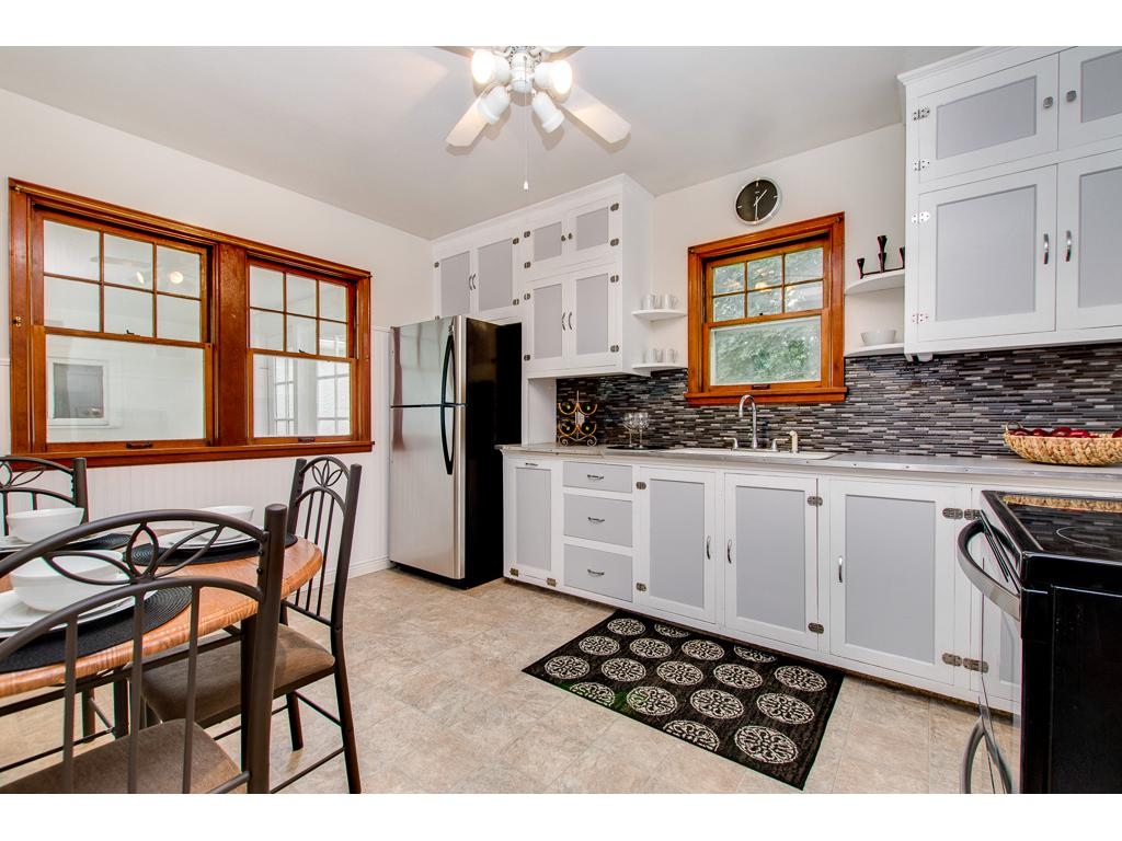 Vintage Kitchen With New Stainless Appliances And Bead Board Walls