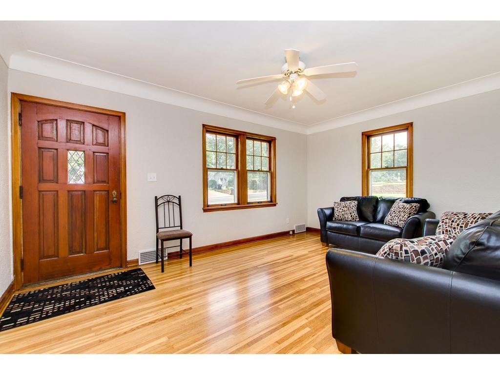 Beautiful Hardwood Floors In The Living Room & Original Front Door