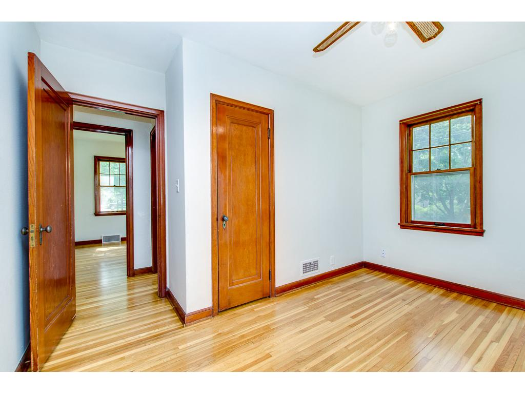 Beautiful Hardwood Floors Continue Through the 2 Main Floor Bedrooms & Hallway