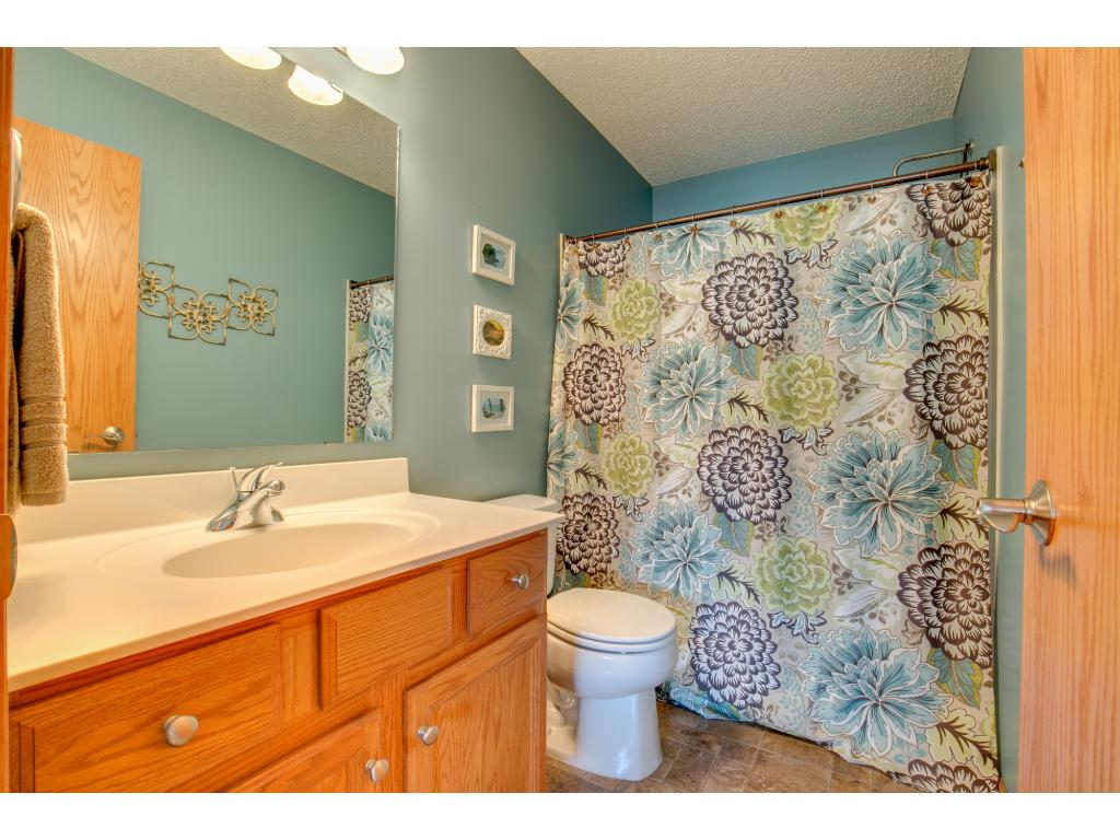 Master Bathroom has a garden tub & shower with oak vanity w/ cultured marble top