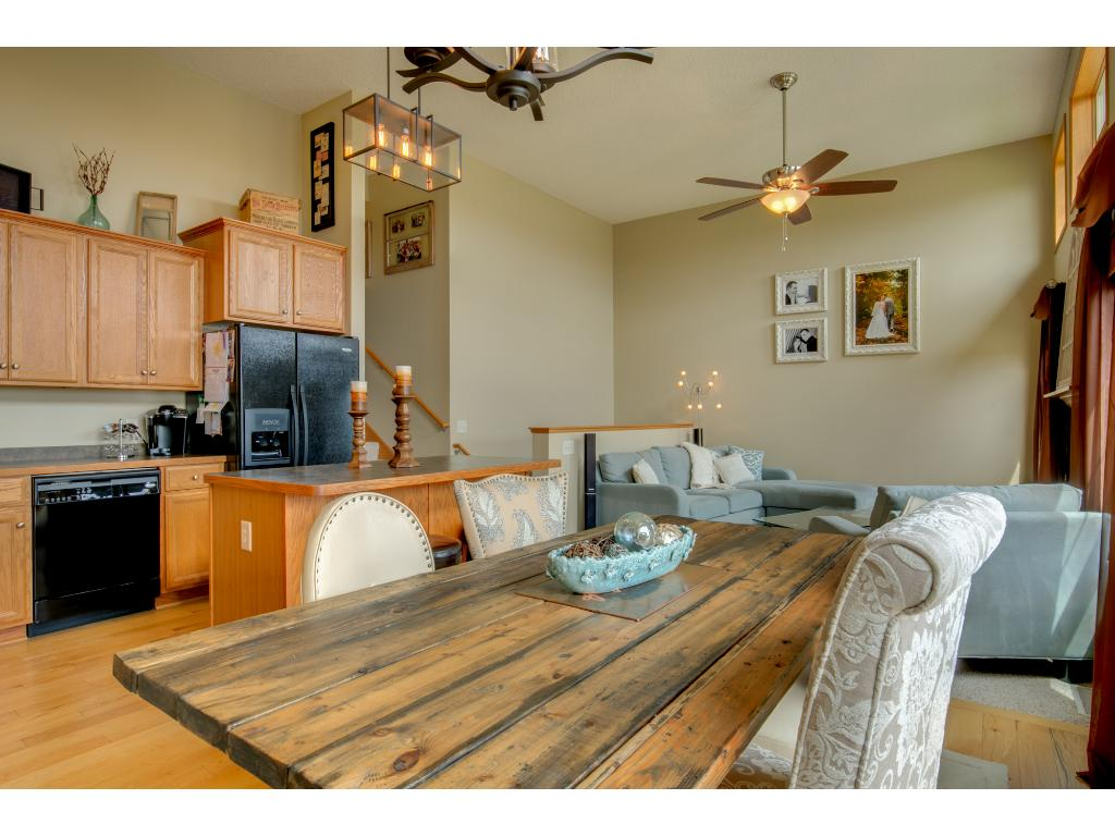 Dining room has oak hardwood flooring and patio door access to private, maintenance free deck.