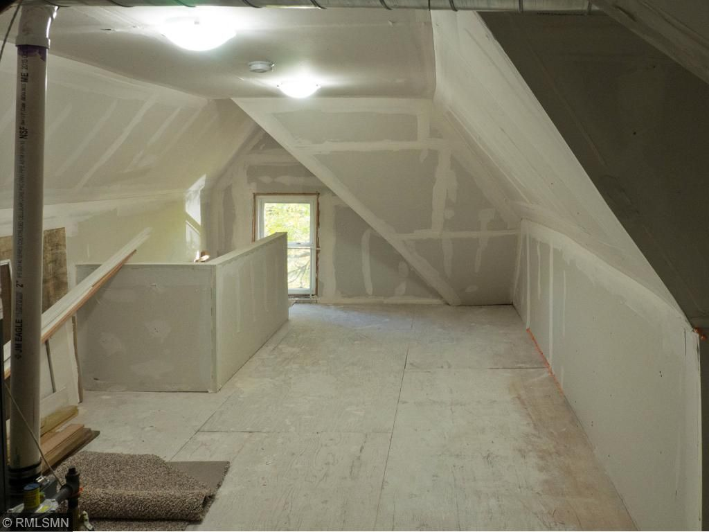 attic space in upper unit houses new water heater and HVAC. Could easily be transformed into additional livable space