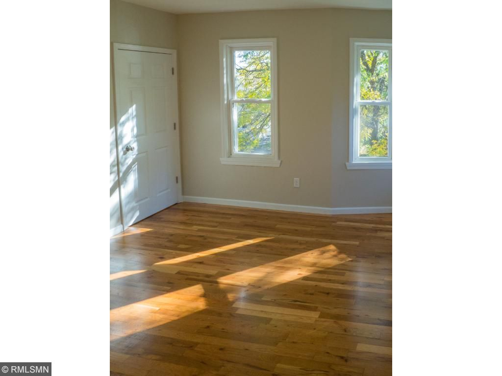 refinished hardwood floors throughout upper unit living room and bedrooms