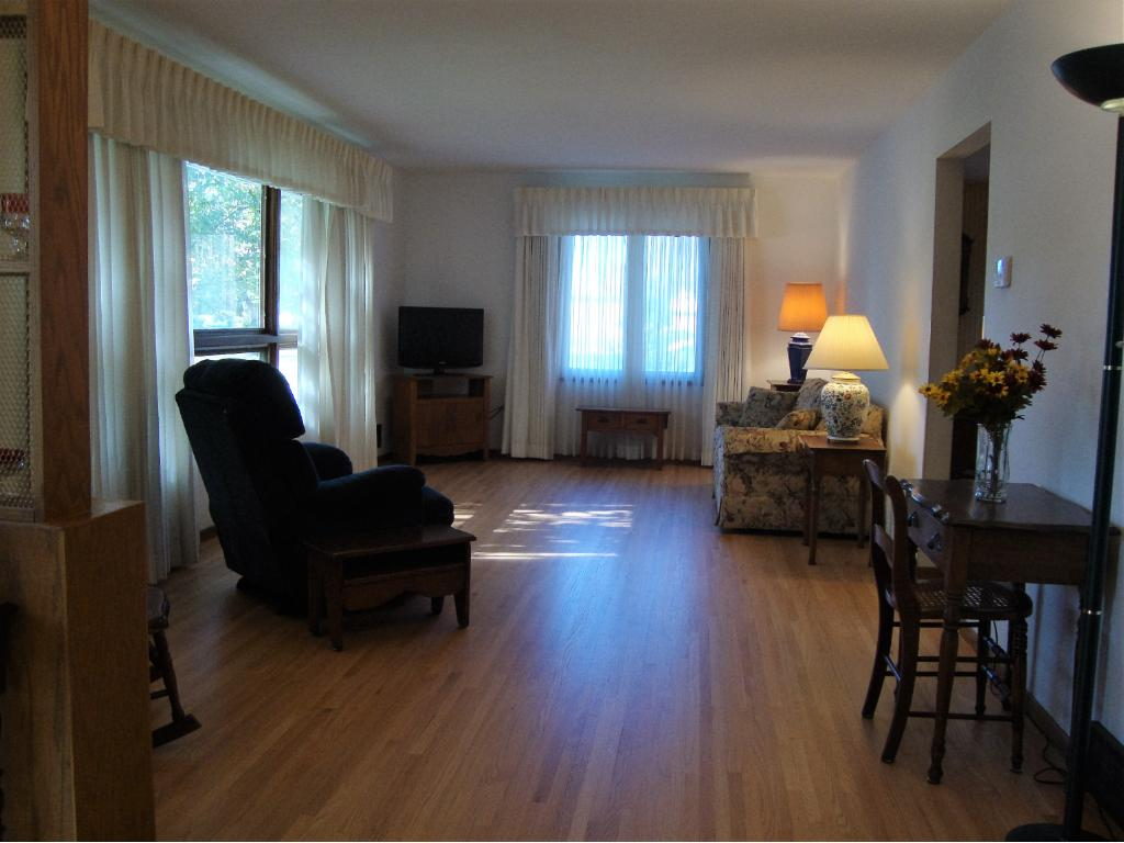Full view of entire living room, notice the beautiful red oak flooring!