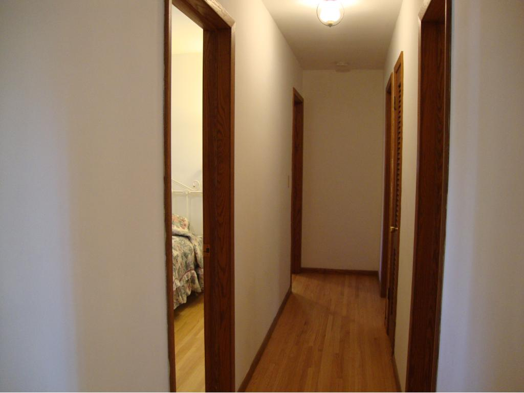 Hallway leading to 3 bedrooms and bath on main floor