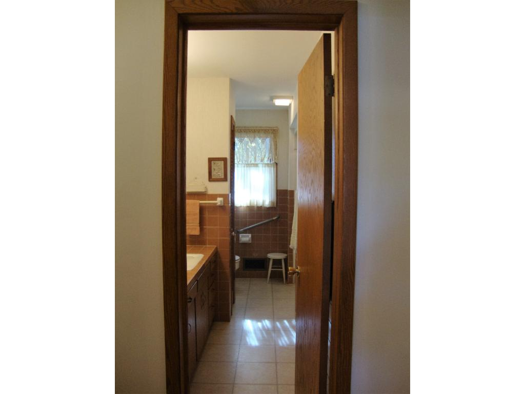 Well maintained bathroom with nice tile.