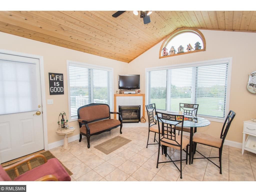 Cozy sunroom with gas fireplace that walks out to the deck.