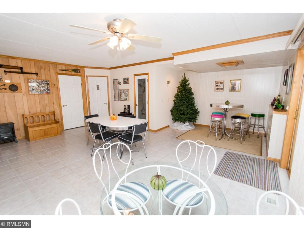 Bonus flex room! Could be used as party room.  Features a bathroom, sauna, & hot tub hookup.  Walks out to patio & gazebo.