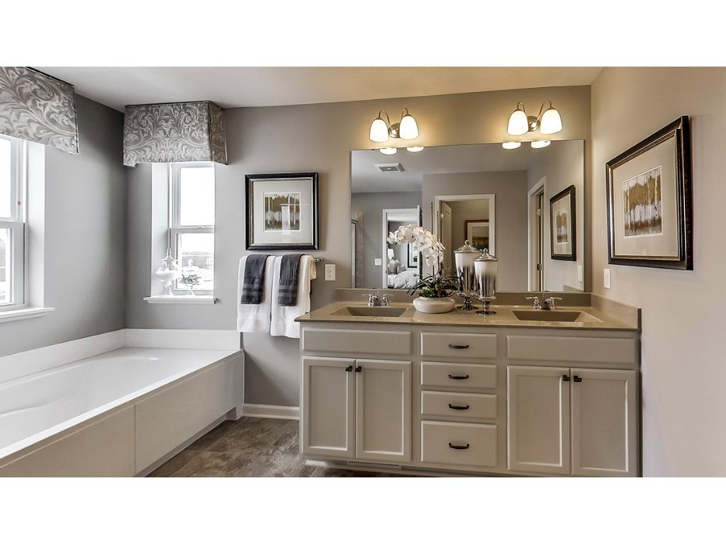 Owners bath and huge walk-in closet.  Photos are of model.