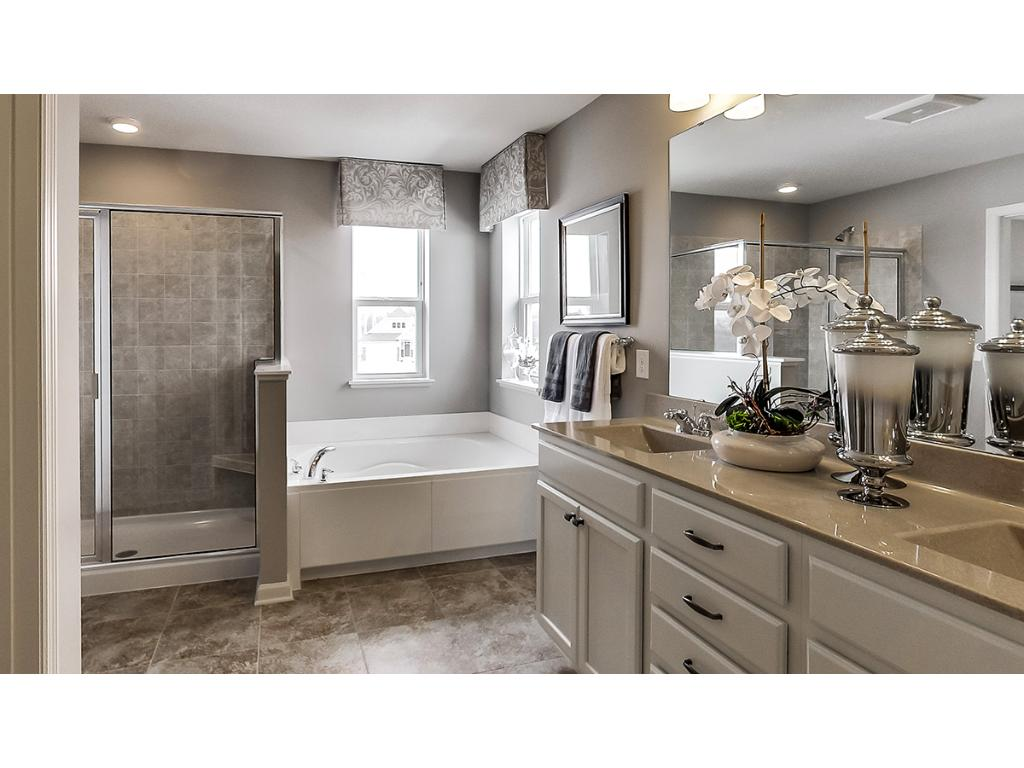 Another view of the owner's bath.  Photos are of model