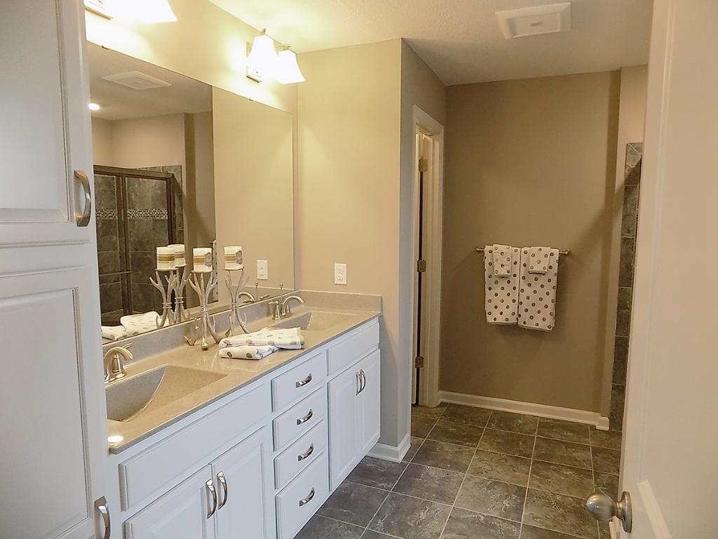 Double vanity completes the main bath.  Photos are of model.