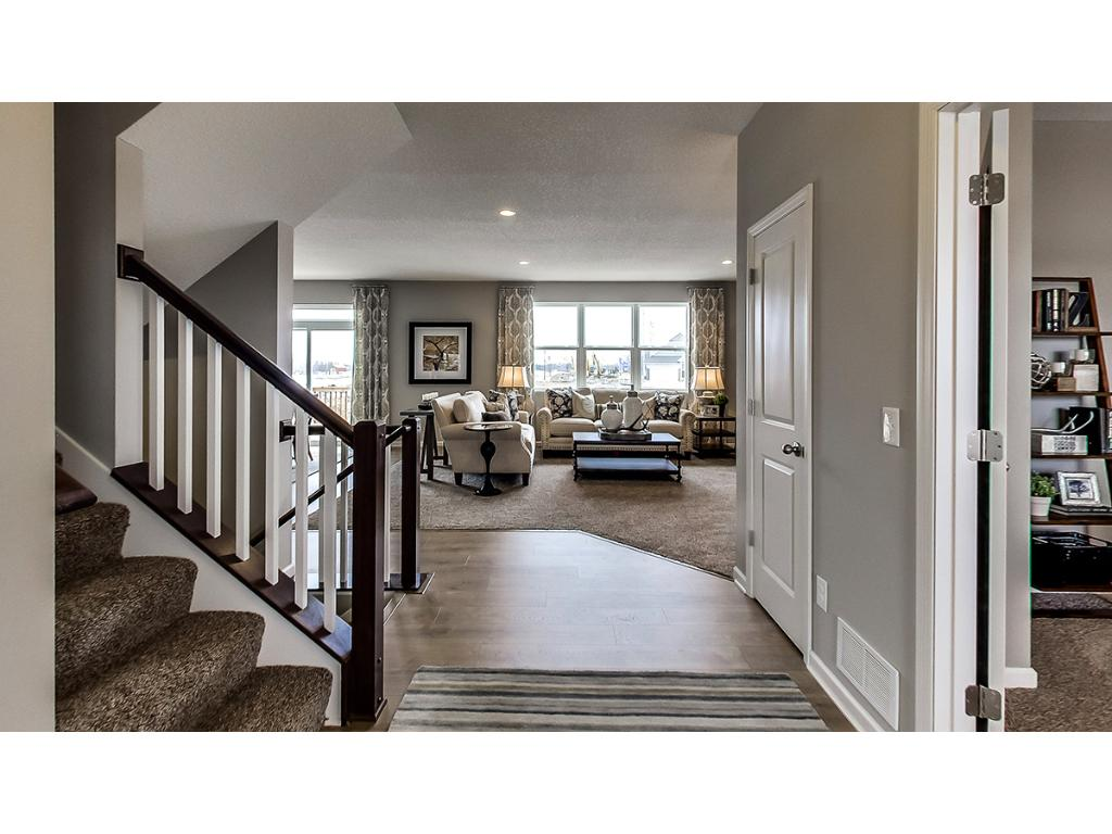 Inviting foyer for family and guests alike.  Photo of model.