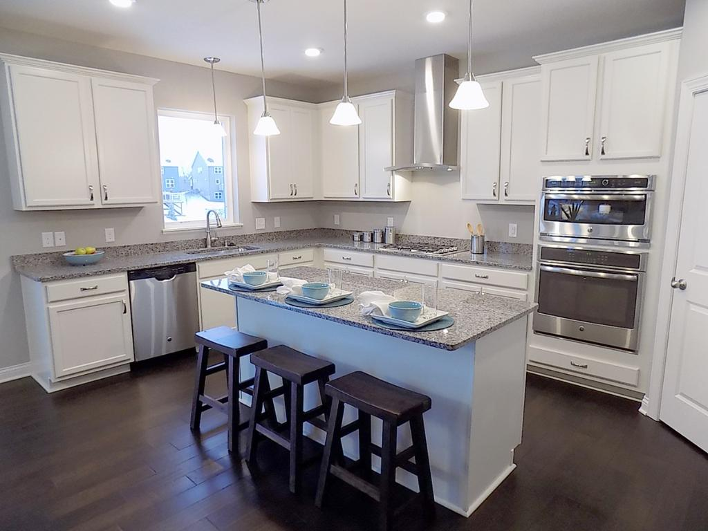 Gourmet kitchen covered in granite.  Photos are of model.