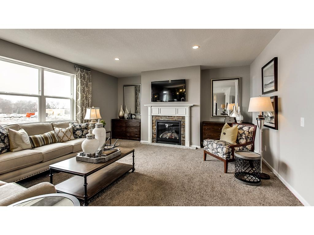 Gas fireplace with built-in's complete this main floor family room.  Photos are of model.