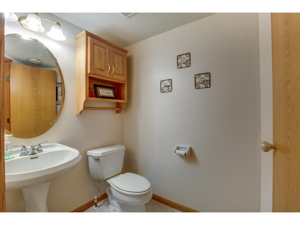 Main level 1/2 bathroom conveniently located near the mudroom & garage.