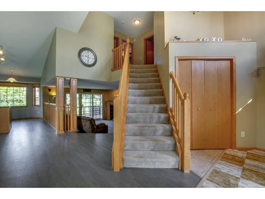 The elegant staircase leading to the upper level is welcoming and flows with the open airy feeling of the home.