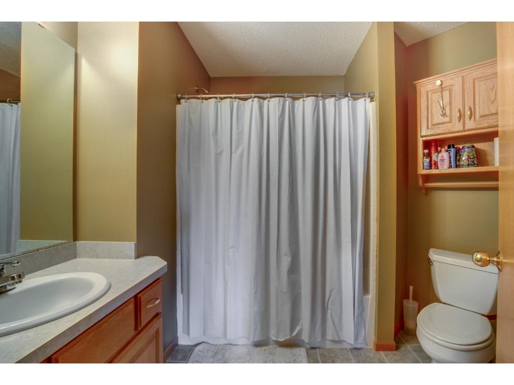 Upper level full bathroom located adjacent to three bedrooms.  Landing near upper level bathroom is spacious, and has built-ins for extra storage.