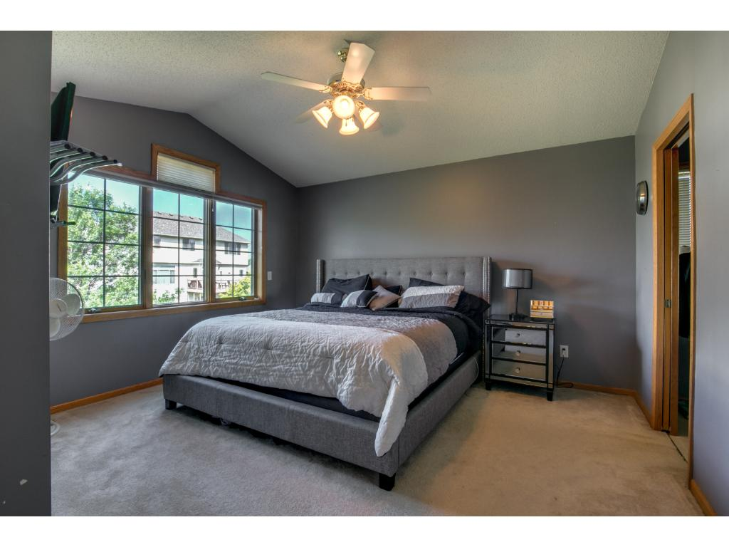 French doors open into the large Master Bedroom suite with private bathroom and over-sized walk-in closet.