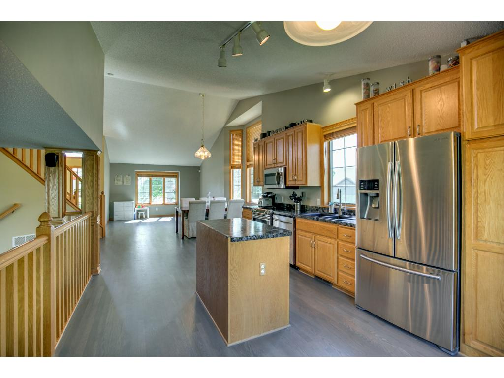This kitchen has it all!  Stainless steel appliances, window over sink to take in the beautiful landscaping of the side yard.  Enough room to install a larger center island should you desire.