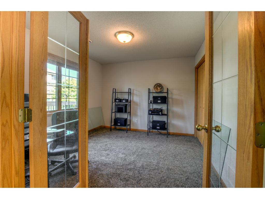 Main level bedroom or office off living room with beautiful french glass doors.