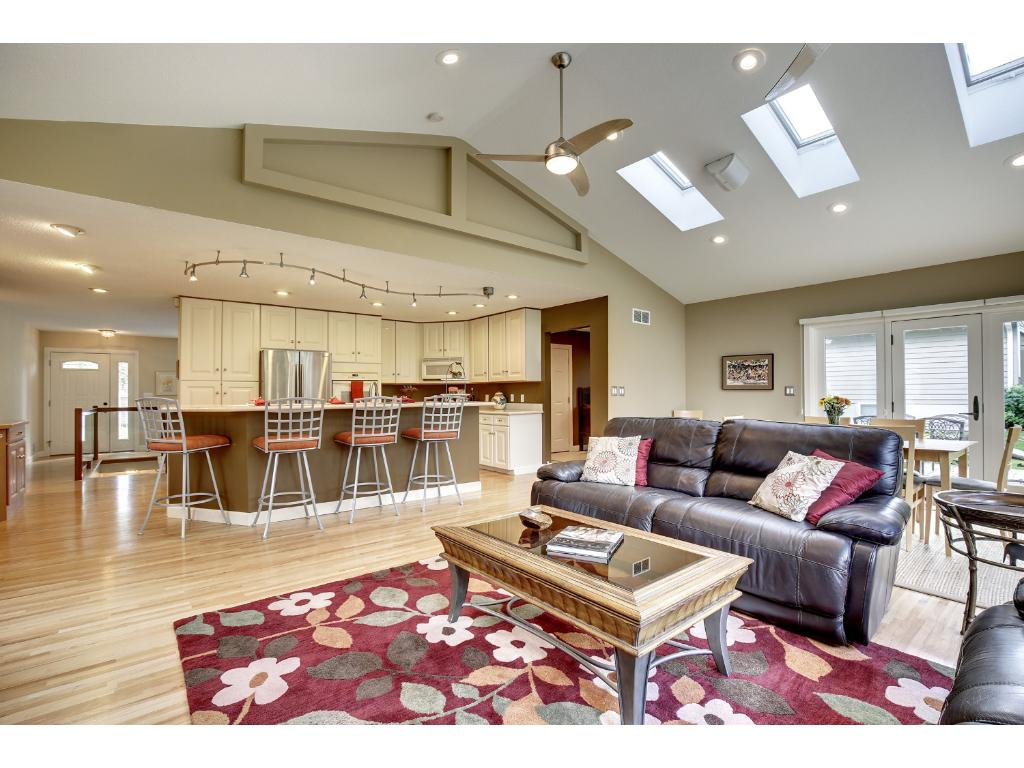 Truly impressive, the added family room & informal dining areas are dramatically vaulted and include multiple skylights, surround sound, hardwood floors, corner gas fireplace, media built-ins, and a wall of windows!