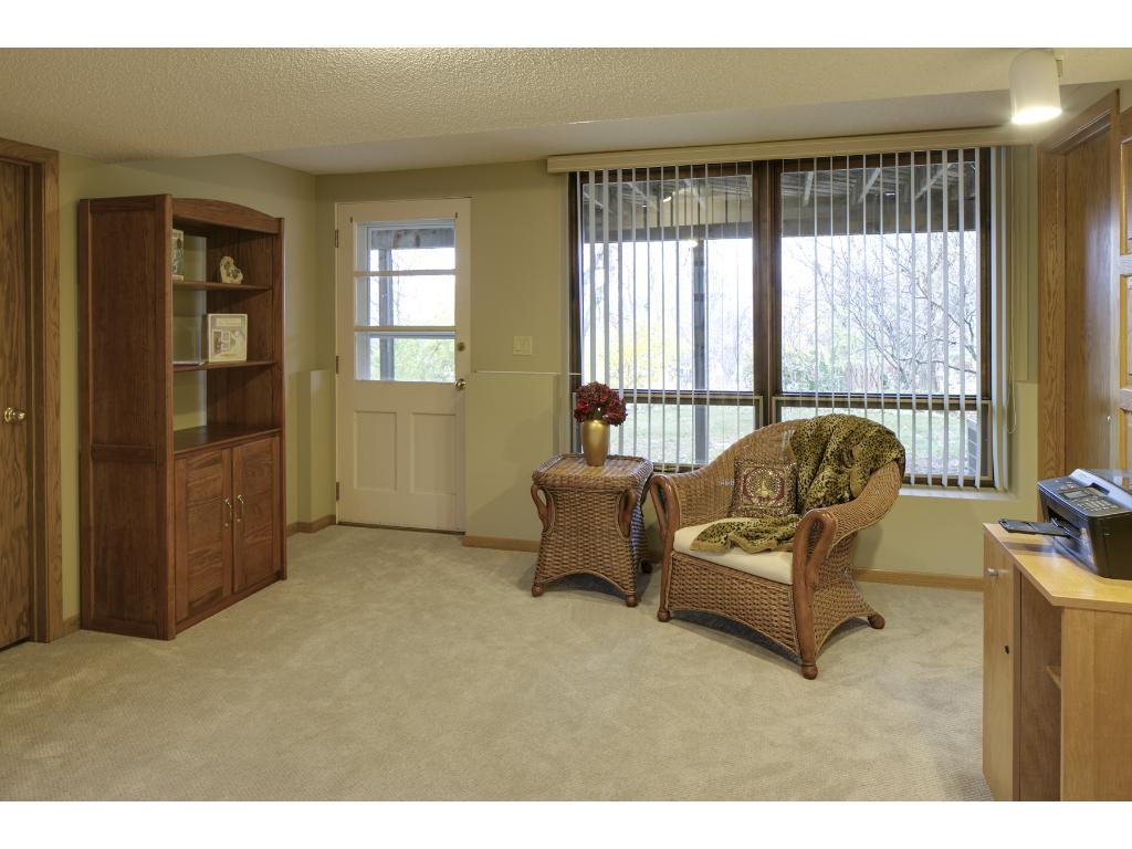 Huge Lower Level 4th bedroom with new laminate flooring and walkout door to rear yard.