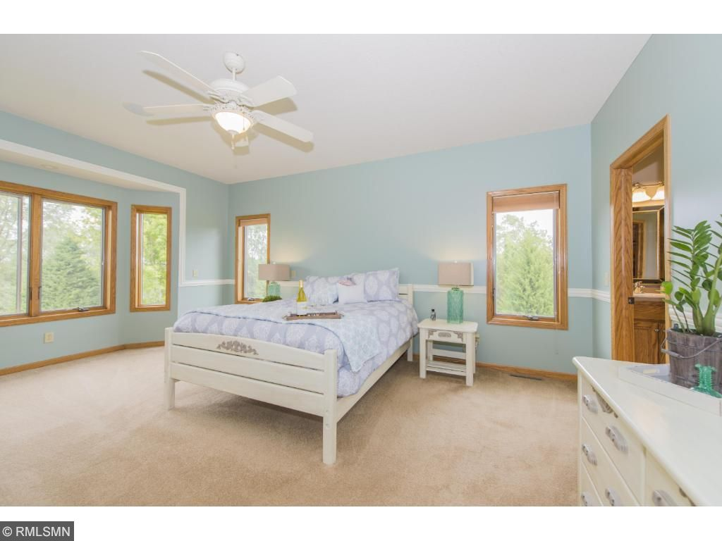 Relax and enjoy the view in this beautiful master suite.