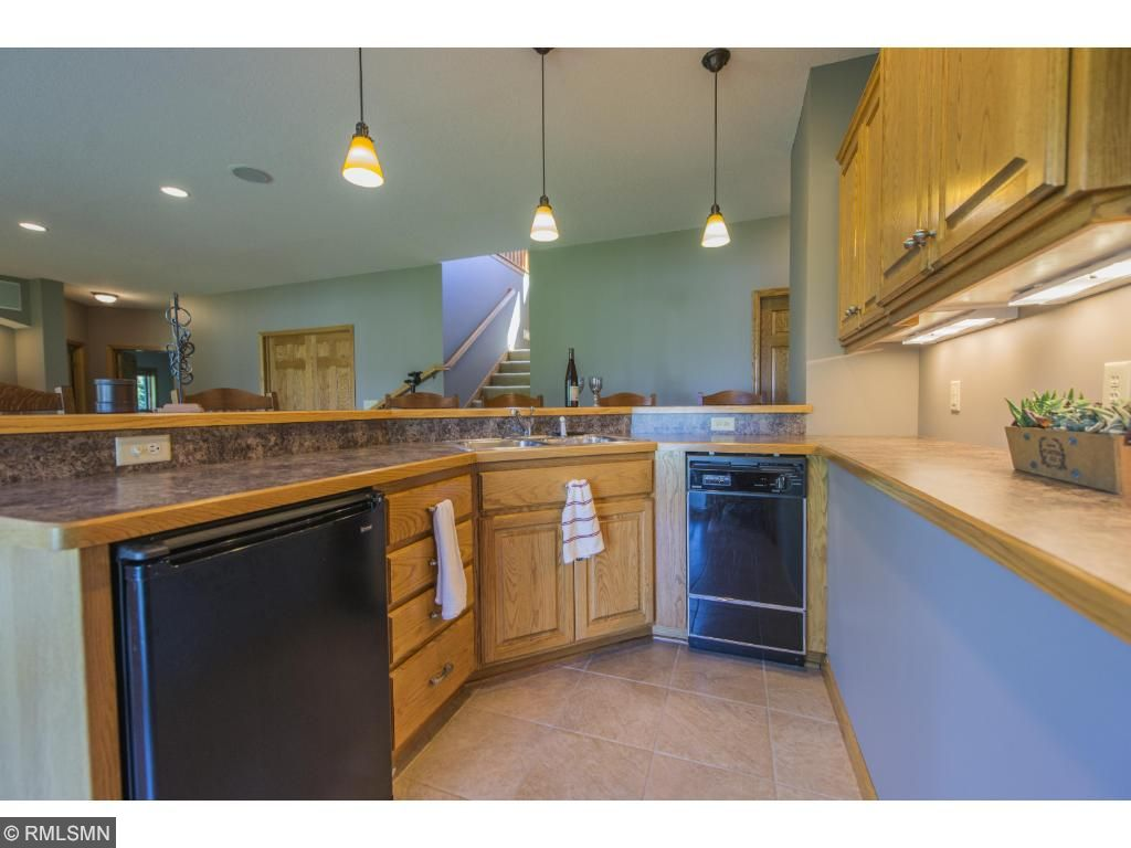Complete wet bar in lower bar is perfect for the having everyone over for the big game and holidays.