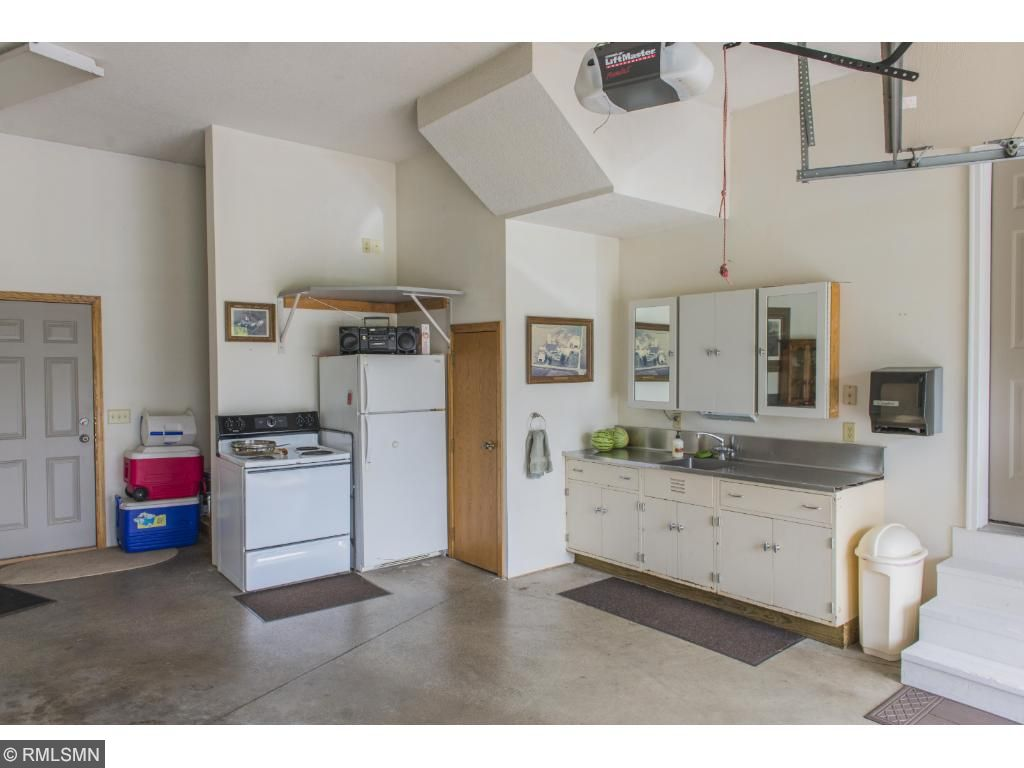 Oversized garage: insulated, heated, w/ floor drain. Bonus storage room above.
