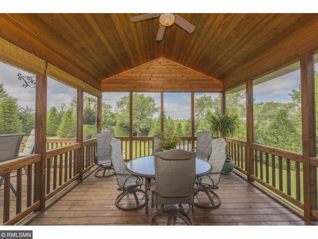 Mulltiple outdoor living spaces. Large 3 season room features cedar ceiling, spacious deck off the 3 season. Relax off the lower level walk out on covered patio. A tucked away space surrounded by trees for laughing around the bonfire. Nature trails.